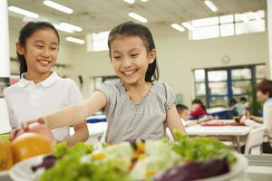 Students eating in the cafeteria.