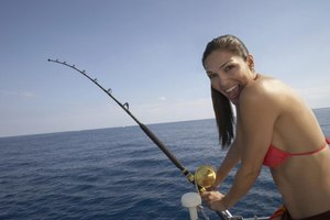 A woman is saltwater fishing.