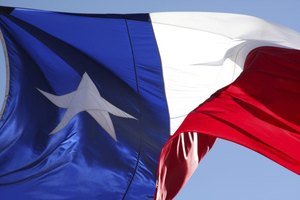 The flag of Texas blows in the wind.