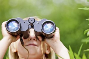 Young Girl Scout holding binoculars