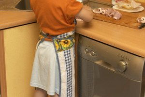 Preschool kitchen helpers gain a sense of pride in helping feed the family.