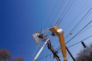 Outside linemen repair electrical lines at great heights.