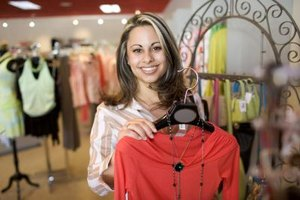 Marketing management fashion merchandisers earn more as they gain experience displaying clothing.