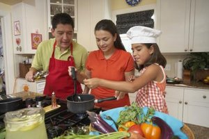 Cooking with your kids promotes nutrition-related conversations.
