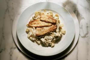 Tilapia served on a bed of pasta makes an easy weeknight dish.