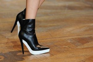 A platform-stiletto bootie can replace the traditional pump for evening outfits.