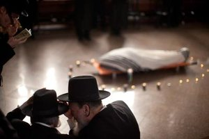 Orthodox Jewish men at a funeral service.