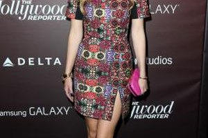 Actress Bella Thorne's black lace-up ankle boots add contrast to an above-the-knee printed dress.