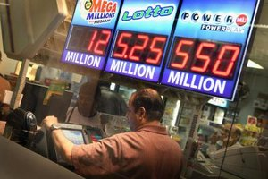 A store in Chicago shows estimated lottery jackpots in November 2012.
