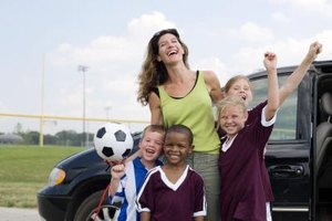 Soccer coaches mentor young players.