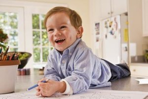 Your toddler can practice writing with art materials.