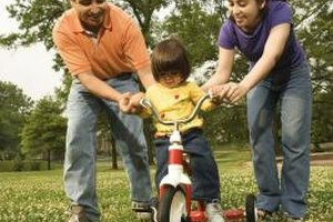 Riding a tricycle helps your three year-old develop large motor skills.