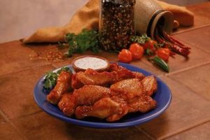 Cut the fat on buffalo wings by broiling them instead of frying.