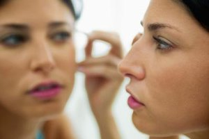 Use a magnifying makeup mirror for better precision.
