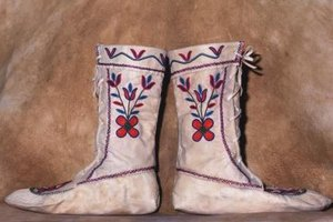 Take valuable beaded moccasins to a professional leather cleaner.