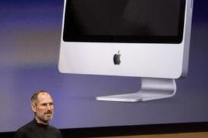 Steve Jobs shows off one version of Apple's iMac.
