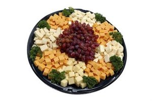 Design a fruit and cheese tray as an easy appetizer.