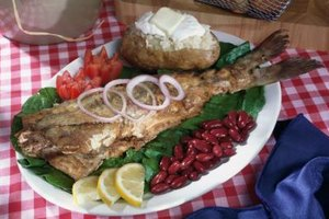 Using flavorful jerk seasoning and cooking over aromatic wood makes for delectable catfish.