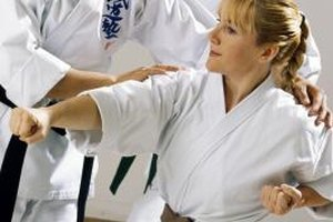 Karate school owners teach students kicks, punches and basic self defense techniques.