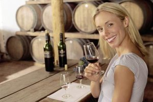 A tasting room manager ensures that wine tastings go smoothly.