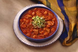 Add pork stomach to pozole, a traditional Mexican stew.