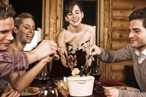 Turn cheese fondue into a meal with a variety of breads, produce and meats.