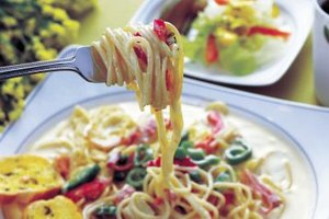 Top pasta with fish and other fresh ingredients.