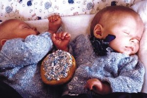 Though they're cute, identical outfits make telling newborn twins apart more difficult.