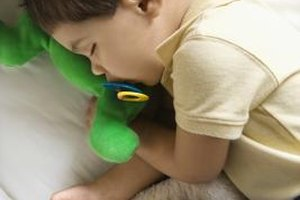 Many toddlers still need a pacifier to sleep.