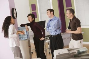 Staying out of the water cooler gossip can keep you out of trouble at work.