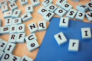 Help your child learn to spell with letter tiles.
