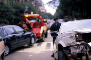 How Do I Handle the Auto Insurance Claim When I Was Rear Ended by Another Driver?