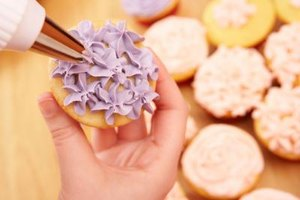 Create whimsical cupcakes by using colored frosting.