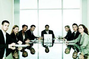 A secretary to the board may be employed by a corporation or nonprofit organization.