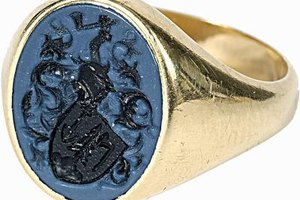 A fraternity ring can serve as a prized possession for a pledge.