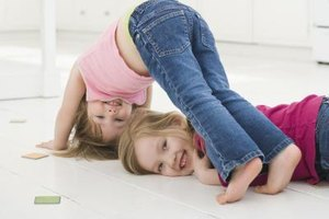 Prepare a soft surface to tumble around with your toddler.