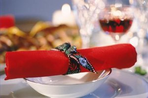 "Simple, creative napkin wraps are ""bound"" to please your guests."
