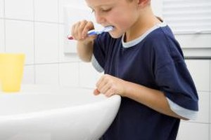 Teach your children proper tooth brushing technique to guard against plaque buildup.