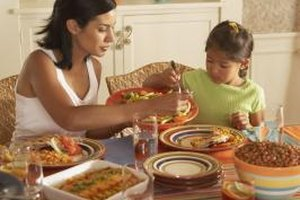 Don't just tell your children about good table manners -- show them as well.