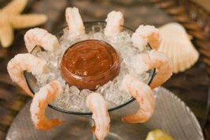 A traditional shrimp cocktail appetizer will please party guests.