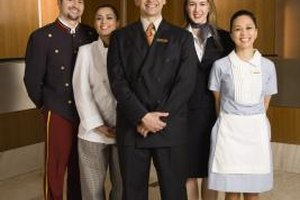 A hotel manager must balance supervisory and guest service functions.