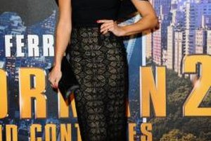 "Wearing a black blouse with a sleek lace skirt, actress Zoe Hardman attends the UK ""Anchorman 2"" premiere in 2013."