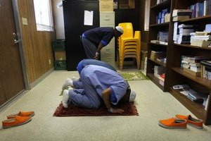 Muslim employees pray in a designated area.