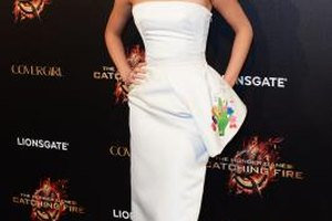 Jennifer Lawrence is stunning from head to toe in a white dress and hot pink pumps.