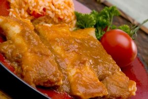 Enchilada sauce soaks into tortillas and coats the top of the dish.