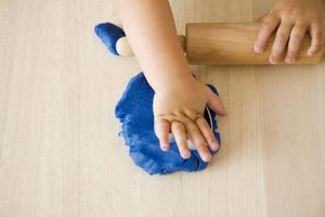 Modeling clay can help your toddler strengthen his hands and fingers.