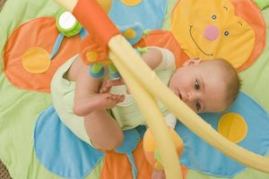 Activity mats can help infants learn about hand-eye coordination and cause and effect.