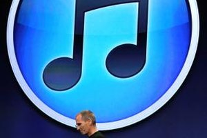 Transfer downloaded MP3 files to your iPhone with iTunes.