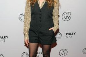 Natasha Lyonne pairs a fun patterned button-down blouse with her vest to give it a menswear-inspired look.