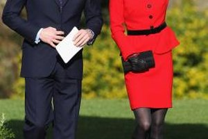 Kate Middleton pairs a polished pencil skirt with boots during an appearance with Prince William.